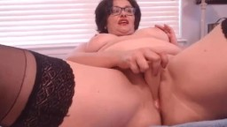 Horny curvy granny Lidya with sexy glasses and accent