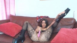 Tattooed brunette Ramona Jones in sexy stockings and high heels