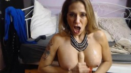 Passionate busty Melissa Johnson doing a gagging blowjob