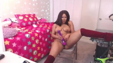 Adorable ebony babe April enjoys her purple vibrator