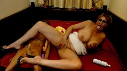 Hot MILF Natalia in glasses jumps on a torso toy