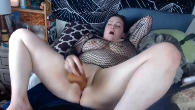 Provocative thick Page masturbates with a huge brown toy