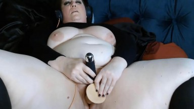 Grey eyed overweight Sam Hayne using a vibrator