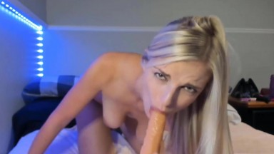 Miss Candy rides a dildo caressing clitoris with a magic wand